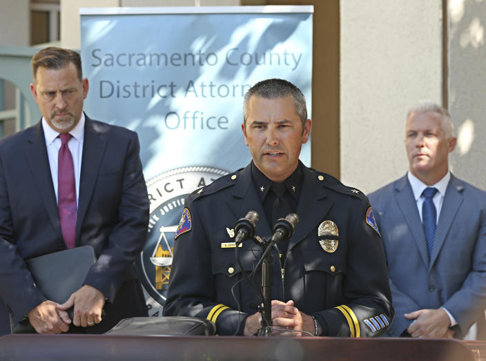 Commander Aaron Johnson, of the Rohnert Park Police Department, center, discusses the arrest of Roy Charles Waller, who is suspected of committing a series of rapes, during a news conference Friday, Sept. 21, 2018, in Sacramento, Calif. Waller, 58, was arrested on Thursday, Sept. 20, by Sacramento Police, and is suspected of committing at least 10 rapes across Northern California between 1991 and 2006. At left, is Brian Staebell, Sonoma County chief deputy district attorney, and Jeff Reisig, Yolo County District Attorney, is at right. (AP Photo/Rich Pedroncelli)