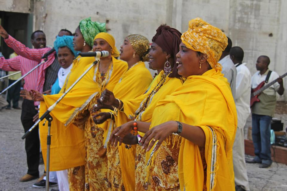 FILE - In this Monday, March 19, 2012 file photo, Somali singers perform at the Somali National Theater in Mogadishu, Somalia. An official says two of Somalia's top sports officials were killed Wednesday, April 4, 2012 in a suicide blast at Somalia's newly reopened national theater that left at least 10 dead. (AP Photo/Farah Abdi Warsameh, File)