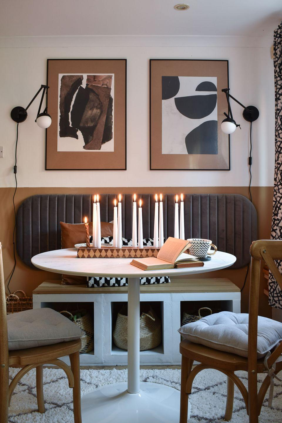 """<p>""""The plan was for the dining nook was to mimic a London café style aesthetic. The seating is <a href=""""https://grillo-designs.com/ikea-kallax-hack-diy-bench/"""" rel=""""nofollow noopener"""" target=""""_blank"""" data-ylk=""""slk:made from"""" class=""""link rapid-noclick-resp"""">made from</a> three<a href=""""https://go.redirectingat.com?id=127X1599956&url=https%3A%2F%2Fwww.ikea.com%2Fgb%2Fen%2Fcat%2Fkallax-series-27534%2F&sref=https%3A%2F%2Fwww.harpersbazaar.com%2Fuk%2Fculture%2Flifestyle_homes%2Fg35595137%2Finside-the-home-of-interiors-blogger-medina-grillo%2F"""" rel=""""nofollow noopener"""" target=""""_blank"""" data-ylk=""""slk:Ikea kallax cubes"""" class=""""link rapid-noclick-resp""""> Ikea kallax cubes</a> and the backing is a bed headboard. The table and chairs are from <a href=""""https://www.next.co.uk/"""" rel=""""nofollow noopener"""" target=""""_blank"""" data-ylk=""""slk:Next."""" class=""""link rapid-noclick-resp"""">Next.</a> I love the abstract art which is by a seller on Etsy called <a href=""""https://go.redirectingat.com?id=127X1599956&url=https%3A%2F%2Fwww.etsy.com%2Fuk%2Fshop%2FGalyaS%3Fref%3Dsimple-shop-header-name%26listing_id%3D511746117&sref=https%3A%2F%2Fwww.harpersbazaar.com%2Fuk%2Fculture%2Flifestyle_homes%2Fg35595137%2Finside-the-home-of-interiors-blogger-medina-grillo%2F"""" rel=""""nofollow noopener"""" target=""""_blank"""" data-ylk=""""slk:GalyaS."""" class=""""link rapid-noclick-resp"""">GalyaS.</a> The <a href=""""https://grillo-designs.com/checkered-diy-candlestick-holder/"""" rel=""""nofollow noopener"""" target=""""_blank"""" data-ylk=""""slk:candle holder centrepiece was a DIY project."""" class=""""link rapid-noclick-resp"""">candle holder centrepiece was a DIY project.</a></p>"""
