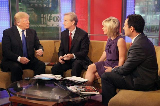 Donald Trump talks with <em>Fox & Friends</em> hosts Steve Doocy, Gretchen Carlson, and Brian Kilmeade in 2011. (Photo: Astrid Stawiarz/Getty Images)