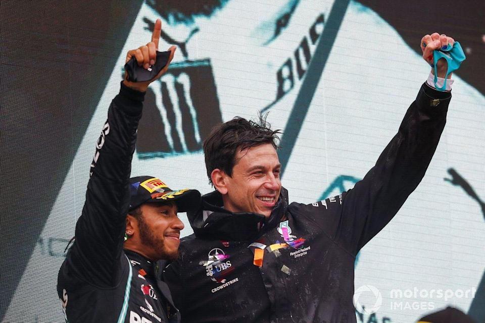 "Lewis Hamilton, Mercedes-AMG F1, on the podium after winning the race, to take his 7th World Championship title, with Toto Wolff, Executive Director (Business), Mercedes AMG <span class=""copyright"">Charles Coates / Motorsport Images</span>"