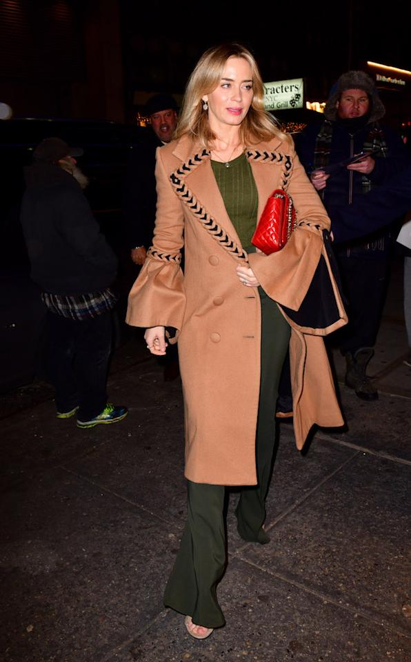 <p>The 'Mary Poppins Returns' actress proved she's not only well dressed in the red carpet department, as she chose a bell-sleeved camel coat and chic wide-leg trousers for an outing in New York. <em>[Photo: Getty]</em> </p>