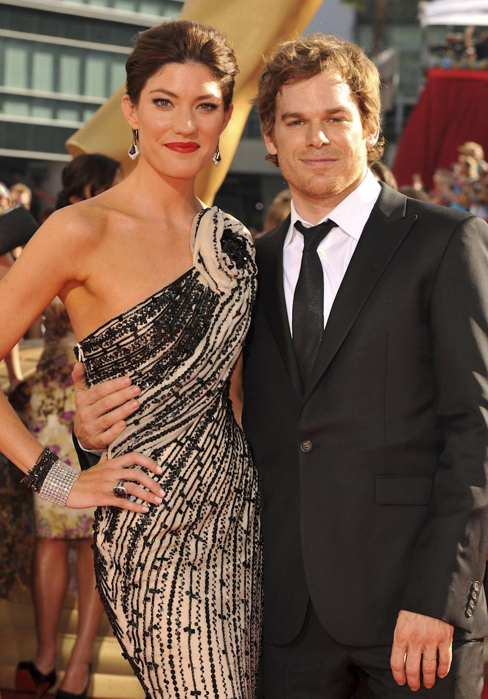 """<p>Though Jennifer and Michael played adoptive siblings Dexter and Debra on <strong>Dexter</strong>, that didn't stop the two from falling for each other. After meeting in 2006, the actors started dating during the show's second season and later tied the knot in 2008. The couple was married for two years before they decided to divorce in 2011, though they continued to star on the show (and even became onscreen lovers) until <strong>Dexter</strong> ended in 2013. </p> <p>In September 2013, <a href=""""http://www.usmagazine.com/celebrity-news/news/jennifer-carpenter-tears-up-talking-about-michael-c-hall-divorce-at-dexter-event-2013139/"""" class=""""link rapid-noclick-resp"""" rel=""""nofollow noopener"""" target=""""_blank"""" data-ylk=""""slk:Jennifer got emotional while discussing their divorce"""">Jennifer got emotional while discussing their divorce</a> at the PaleyFest<strong> Dexter</strong> Fall Farewell event. """"Our marriage didn't look like anyone else's, and our divorce didn't either,"""" she said, later adding, """"I said it before - just because the marriage ended doesn't mean the love did."""" </p>"""