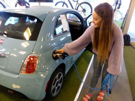 Maiken Skram of Buddy Electric car dealer company shows the charging of a second-hand Fiat 500e, imported from California, U.S., in Oslo, Norway March 15, 2109. Picture taken March 15, 2019. REUTERS/Alister Doyle