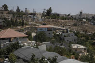 The Israeli army post, right, over looks the shooting site, as seen from the family house of slain Palestinian Mohammed al-Alami, 12, in the West Bank village of Beit Ummar, near Hebron, Wednesday, Aug. 4, 2021. (AP Photo/Nasser Nasser)