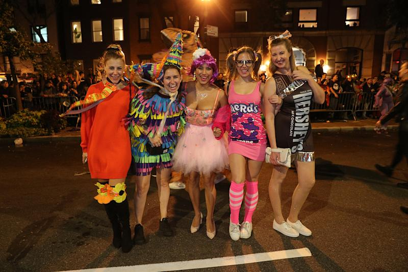 Revelers dressed as candy pose for a photo march in the Halloween Parade in the New York City. (Photo: Gordon Donovan/Yahoo News)