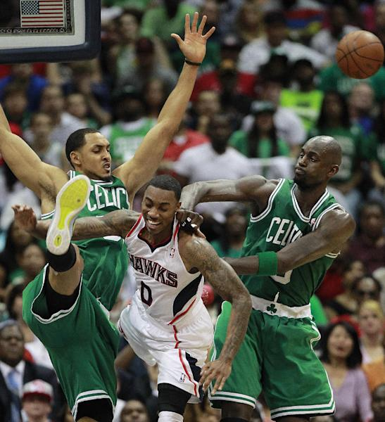 Atlanta Hawks guard Jeff Teague (0) battles Boston Celtics center Ryan Hollins (50) and forward Kevin Garnett, right, for a loose ball during the second half of Game 5 of an NBA first-round playoff series basketball game Tuesday, May 8, 2012, in Atlanta. (AP Photo/John Bazemore)