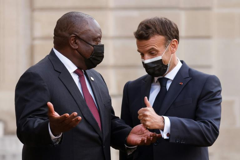 Macron with South African counterpart Cyril Ramaphosa, among more than two dozen African heads of state attending the summit