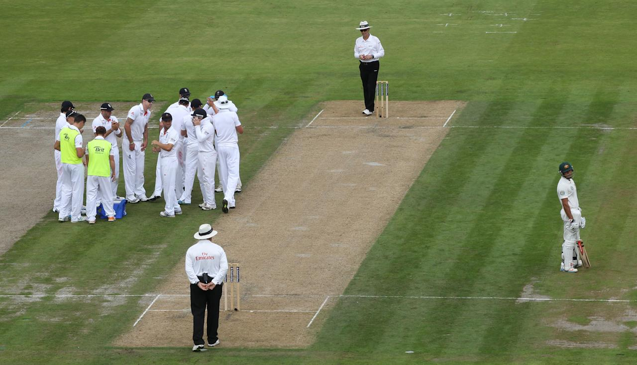 Australia batsman Usman Khawja shows his dejection after he was given out by TV umpire off England bowler Graeme Swann caught by wicketkeeper Matthew Prior during day one of the Third Investec Ashes test match at Old Trafford Cricket Ground, Manchester.