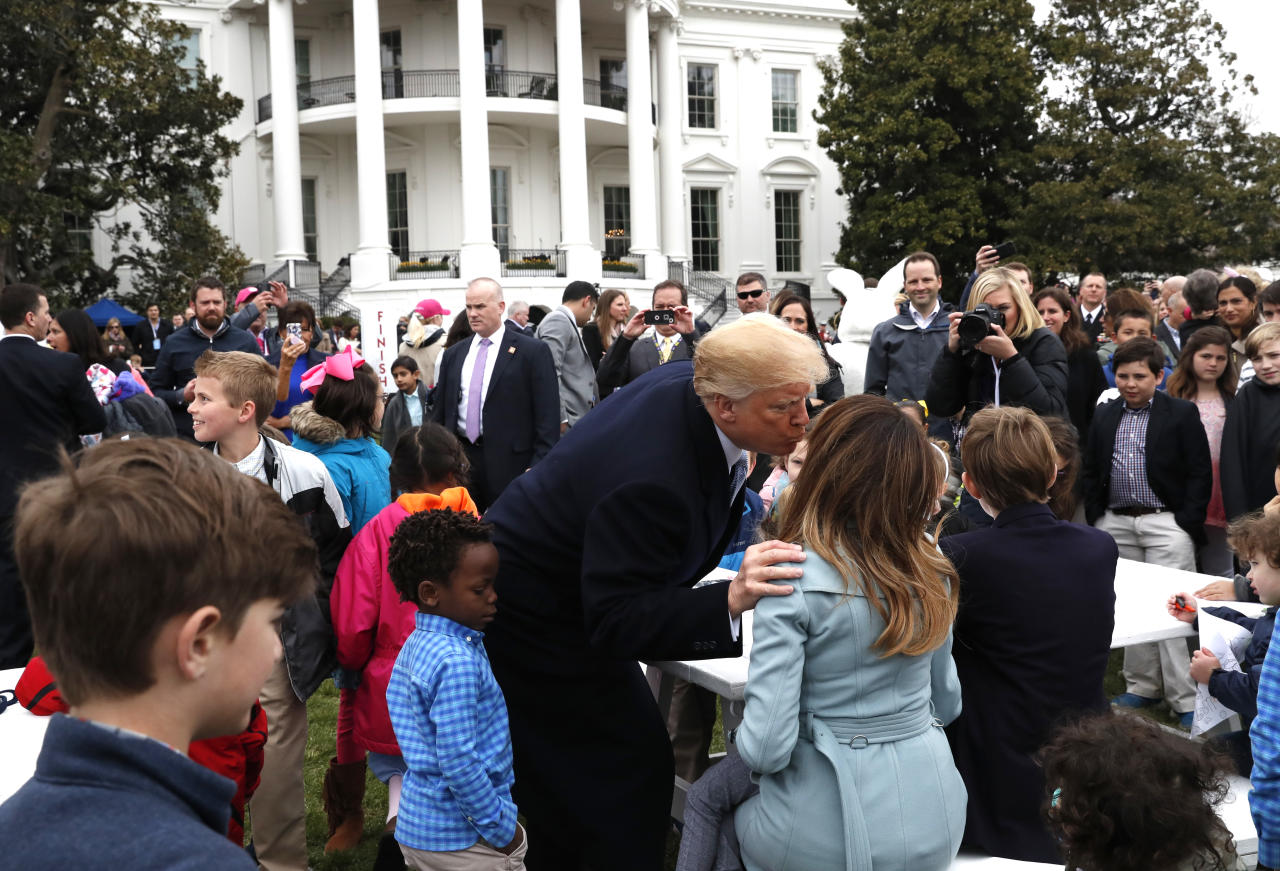 <p>U.S. President Donald Trump kisses first lady Melania Trump among children gathered for the annual White House Easter Egg Roll on the South Lawn of the White House in Washington, U.S., April 2, 2018. (Photo: Leah Millis/Reuters) </p>