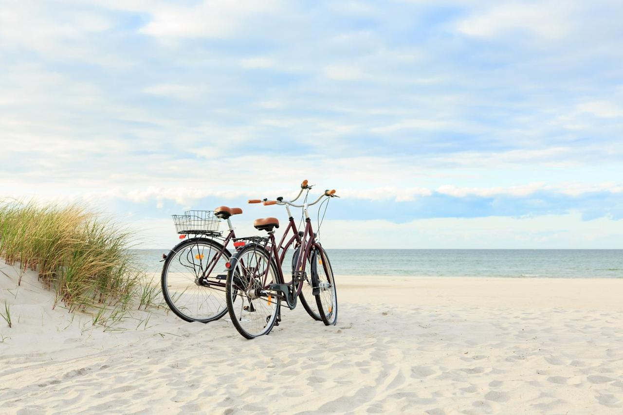 <p>Grab your bikes (or rent a pair) and take a leisurely ride, whether it's to the beach or just down to the center of town. Treat yourselves to a delicious lunch before heading back.</p>
