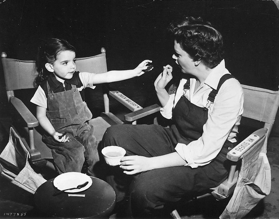 <p>In 1950, she hung out with her mom on the set of <em>Summer Stock</em>, sharing a snack with her between takes. </p>