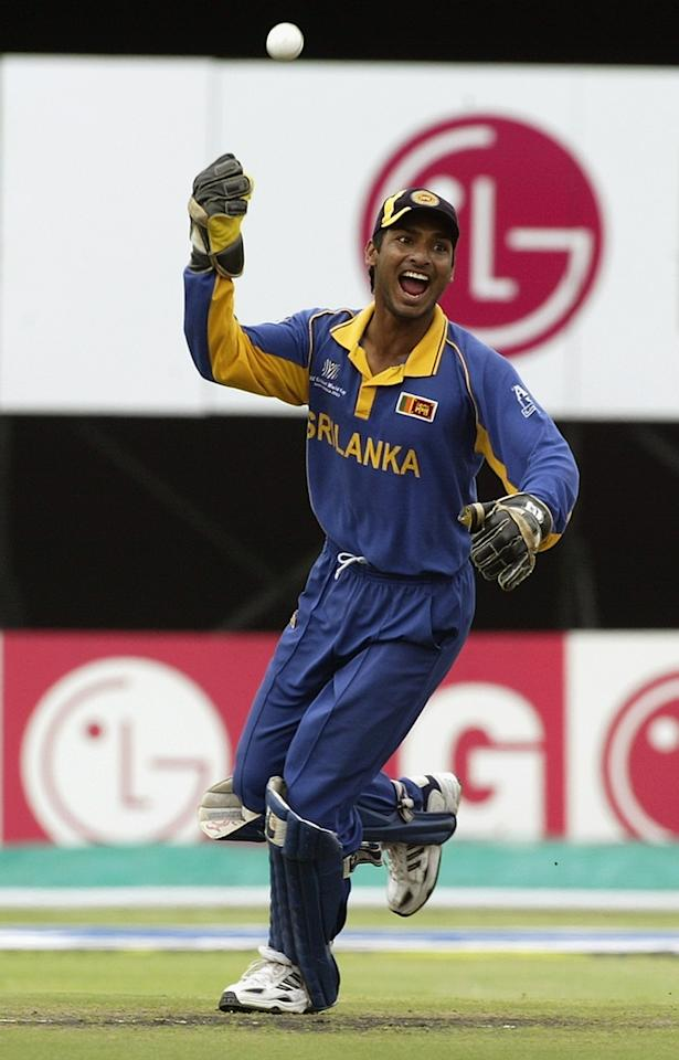 PORT ELIZABETH- MARCH 18:  Kumar Sangakkara of Sri Lanka celebrates catching Adam Gilchrist of Australia during the ICC Cricket World Cup semi final match between Sri Lanka and Australia held on March 18, 2003 at St George's Park in Port Elizabeth, South Africa. Australia won the match by 48 runs. (Photo by Hamish Blair/Getty Images)