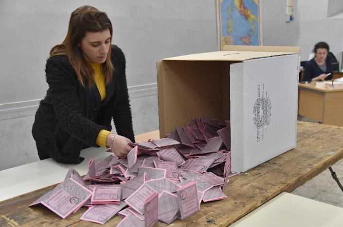A polling station officer prepares the counting of the ballots in Rome (AFP Photo/Andreas SOLARO)