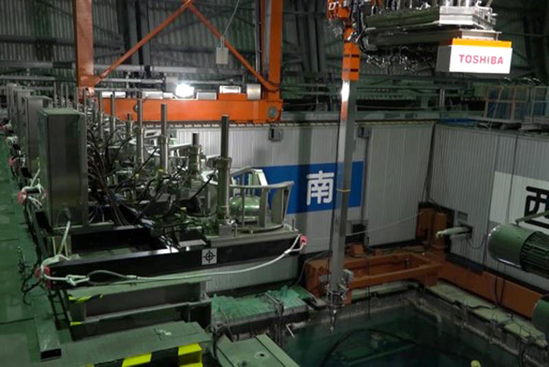 This image released by Tokyo Electric Power Co. (TEPCO) shows the operation floor above a cooling pool at Unit 3 of the Fukushima nuclear power plant in Okuma town, Fukushima prefecture, northeastern Japan, Monday, April 15, 2019. The operator TEPCO of the tsunami-wrecked Fukushima nuclear plant began removing fuel from the cooling pool at one of three reactors that melted down in the 2011 disaster, a milestone in the decades-long process to decommission the plant. (Tokyo Electric Power Co. via AP)