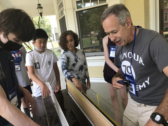 Teacher Jack Klein talks to students about how waves can change size as part of Shipwreck Camp on the campus of Case Western Reserve University. (Patrick O'Donnell)