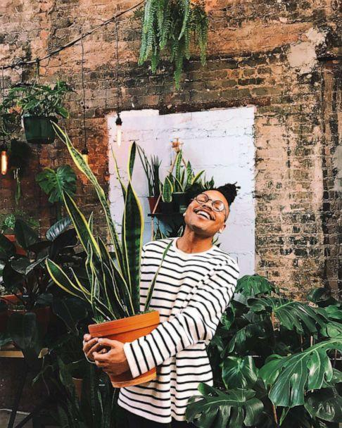 PHOTO: Christopher Griffin poses with a snake plant, his favorite plant. (Christopher Griffin/PlantKween via Instagram)