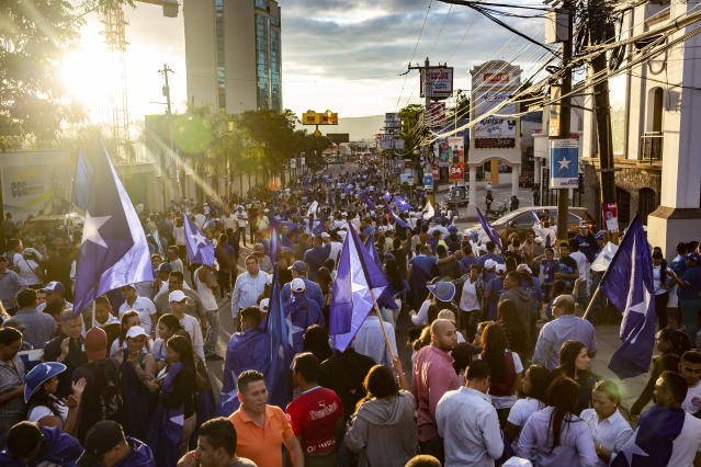 <p>A rally in support of Juan Orlando Hernández current president of Honduras, a conservative U.S. ally. The resuslts of the November 2017 elections were highly controversial. Hernández's ran for a second term last year, after changing the constitution that prevented any president to be elected twice. Human rights organizations documented the murder of 14 people, 51 wounded and 844 detentions, of which 501 have occurred since the suspension of Constitutional guarantees on December 1, 2017, during post-electoral Honduran political crisis. (Photo: Francesca Volpi) </p>