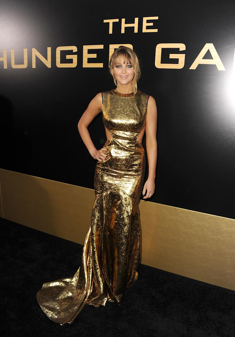She dressed the part of Hollywood's new Golden Girl at the Los Angeles premiere of The Hunger Games wearing a gold Prabal Gurung gown with side cutouts.