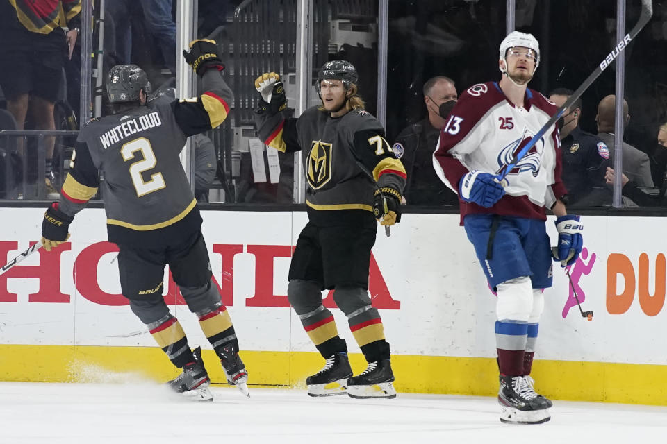 Vegas Golden Knights defenseman Zach Whitecloud (2) celebrates after center William Karlsson (71) scored a goal against the Colorado Avalanche during the first period in Game 6 of an NHL hockey Stanley Cup second-round playoff series Thursday, June 10, 2021, in Las Vegas. (AP Photo/John Locher)