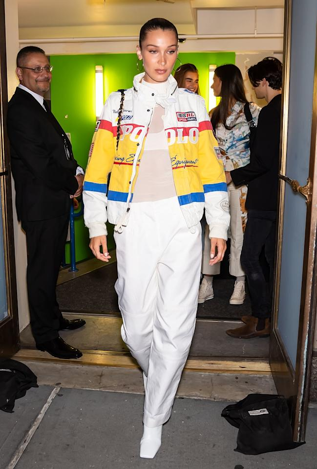 <p>Bella wore her tall white Isa boots with a Polo Ralph Lauren jacket.</p>