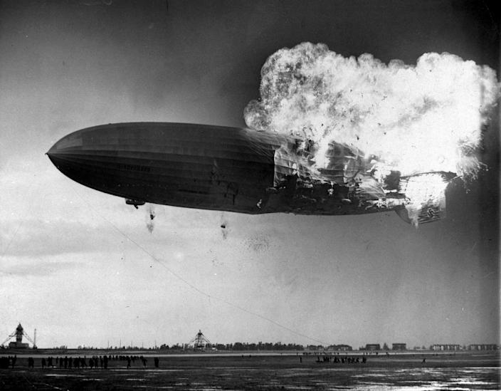 <p>The German zeppelin Hindenburg bursts into flames as it noses toward the mooring post at the Naval Air Station in Lakehurst, N.J. on May 6, 1937. Thirty-five people on board and one ground crew member were killed. (AP Photo/Murray Becker) </p>