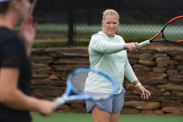 Retired tennis tour professional Melanie Oudin coaches youngsters at Windward Lake Club on Monday, Aug. 26, 2019, in Alpharetta, Ga. A decade after her magical and memorable Grand Slam stay in New York, which followed a just-as-surprising run from qualifier to the fourth round at Wimbledon--like another American teen, Coco Gauff, did to much more fanfare this summer--Oudin is retired from the WTA tour, teaching kids the sport she loves and hoping to coach a pro one day. (AP Photo/John Amis)