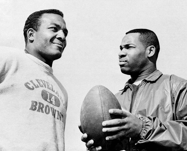 FILE - In this Jan. 11, 1964, file photo, fullback Jim Brown, left, and flanker back Bobby Mitchell, once a feared duo for the Cleveland Browns before Mitchell was dealt to Washington, are back together as teammates, as they prepare for the annual Pro Bowl at Los Angeles. Mitchell, the speedy late 1950s and 60s NFL offensive star the Browns and the Washington Redskins, has died. He was 84. The Pro Football Hall of Fame said Sunday night, April 5, 2020, that Mitchells family said he died in the afternoon. (AP Photo/Harold Filan, File)