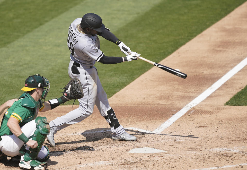White Sox rookie Luis Robert crushes a 487-foot home run during Game 3 of the wild-card series. (Photo by Thearon W. Henderson/Getty Images)