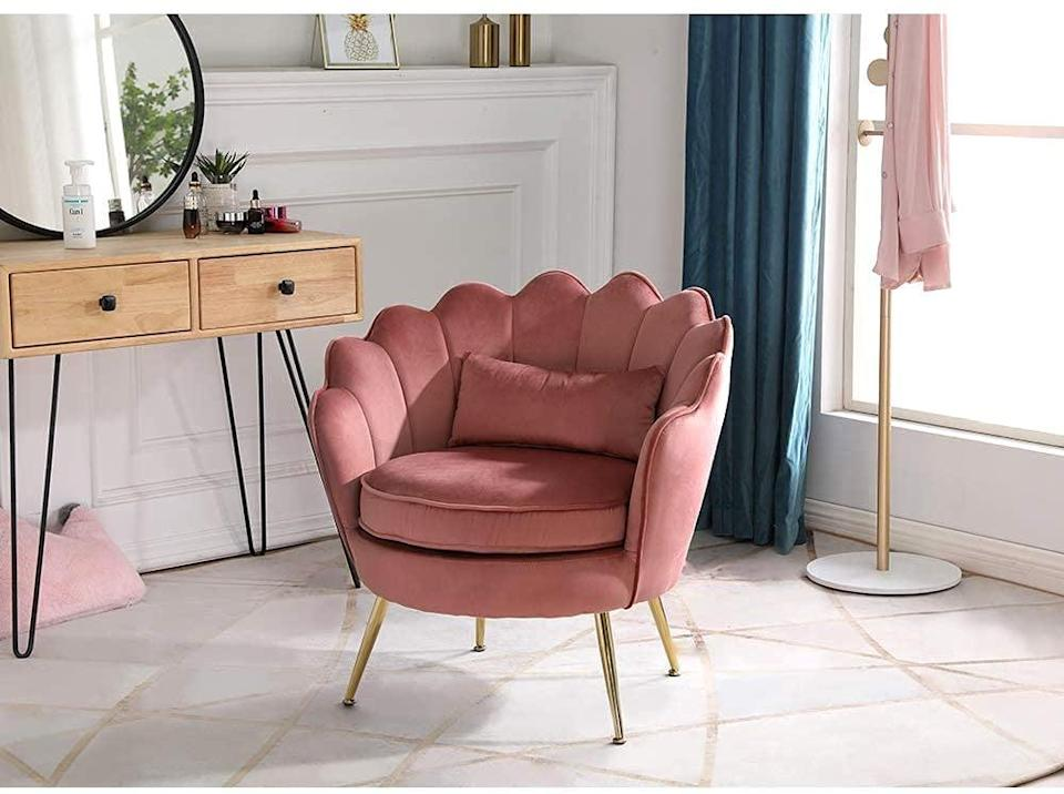 <p>This eye-catching <span>WQSLHX Velvet Chair with Lumbar Pillow</span> ($160) belongs right in front of your vanity mirror. The unique petal shape gives it a decorative flowerlike look, while the mid-century design will blend well with any roon.</p>