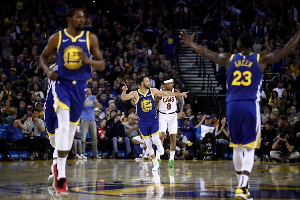 OAKLAND, CALIFORNIA - APRIL 05: Stephen Curry #30 of the Golden State Warriors reacts after making a basket against the Cleveland Cavaliers at ORACLE Arena on April 05, 2019 in Oakland, California. (Photo by Ezra Shaw/Getty Images)