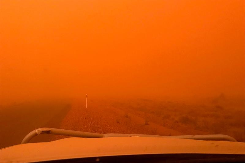 Dust storm in the outback: The dust storm left an eerie red haze it its wake.
