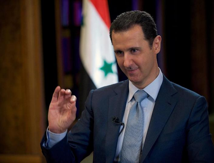 Syria's exiled opposition insist that President Bashar al-Assad -- who has been in power since 2000 -- must step down before they can agree in any resolution to end the country's four-year-old conflict (AFP Photo/)