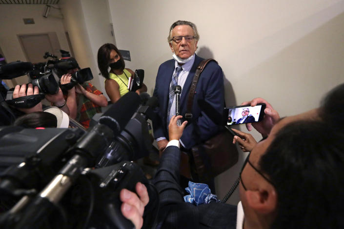Attorney John Henry Browne speaks with media members after a court appearance by his client, Dawit Kelete, Monday, July 6, 2020, in Seattle. Kelete is accused of driving a car on to a closed Seattle freeway and hitting two protesters, killing one, over the weekend. Seattle has been the site of prolonged unrest over the death of George Floyd, a Black man who was in police custody in Minneapolis, and had shut down the interstate for 19 days in a row. (AP Photo/Elaine Thompson)