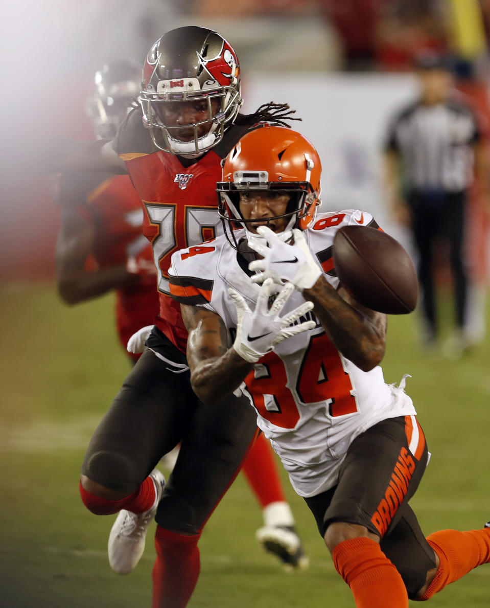 Tampa Bay Buccaneers cornerback Vernon III Hargreaves III (28) knocks the ball away from Cleveland Browns wide receiver Derrick Willies (84) during the first half of an NFL preseason football game Friday, Aug. 23, 2019, in Tampa, Fla. (AP Photo/Mark LoMoglio)
