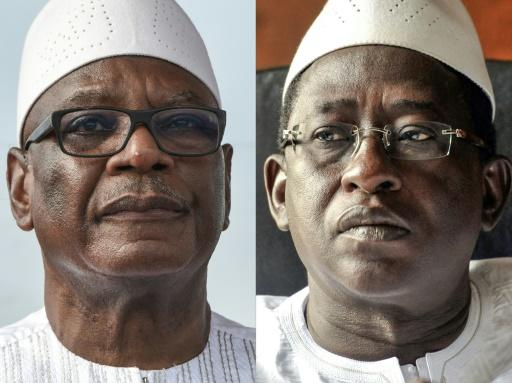 President Ibrahim Boubacar Keita (L) won a landslide victory against opposition leader Soumaila Cisse (R), according to official results