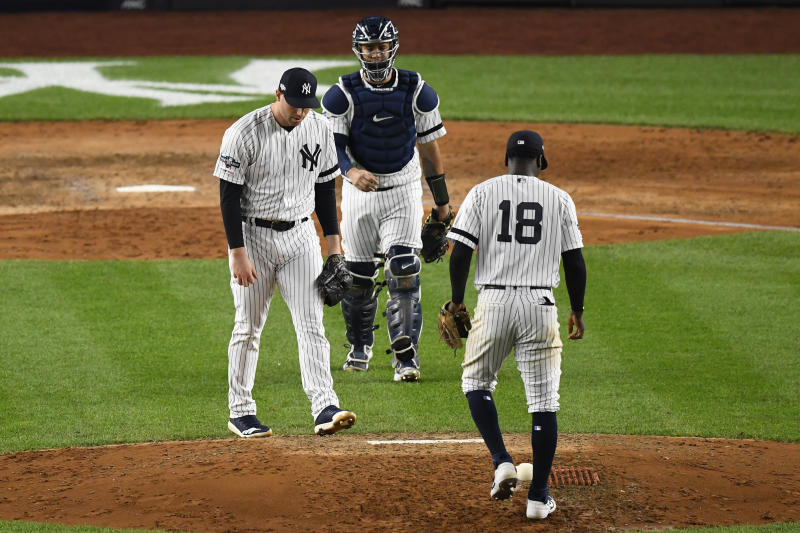Oct 15, 2019; Bronx, NY, USA; (Editors Notes: Caption Correction) New York Yankees relief pitcher Adam Ottavino (0) reacts after giving up a single to Houston Astros second baseman Jose Altuve (not pictured) as shortstop Didi Gregorius (18) and catcher Gary Sanchez (24) look on during the seventh inning of game three of the 2019 ALCS playoff baseball series at Yankee Stadium. Mandatory Credit: Robert Deutsch-USA TODAY Sports