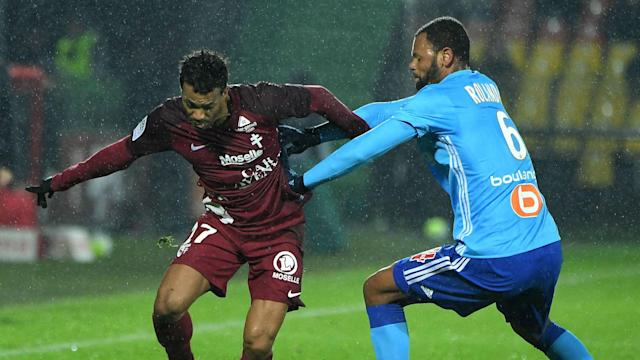 Marseille handed bottom side Metz their eighth straight home defeat on Wednesday - a first in Ligue 1 history.