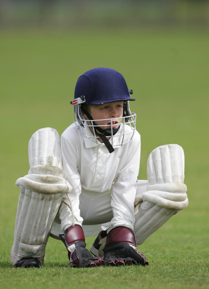 LONDON - AUGUST 14: A young wicketkeeper looks on at The Spencer Club on August 14, 2005 in London. (Photo by Clive Rose/Getty Images)