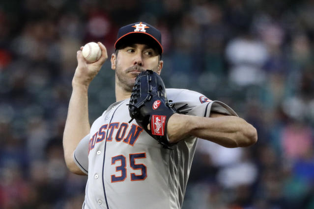 Houston Astros starting pitcher Justin Verlander throws against the Seattle Mariners in the fourth inning of a baseball game Saturday, April 13, 2019, in Seattle. (AP Photo/Elaine Thompson)