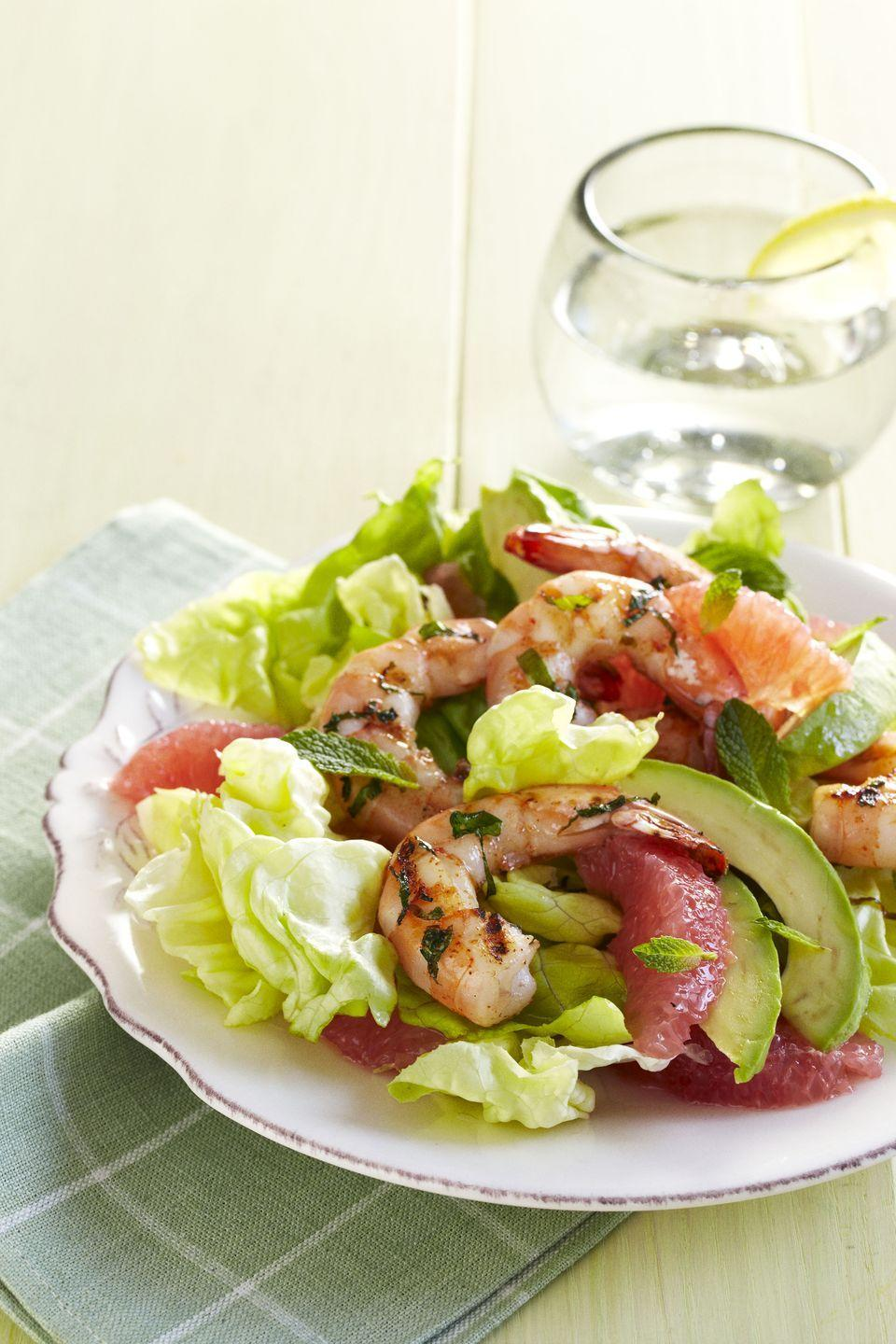 """<p>If you're into fresh ingredients with a bit of a kick, this combo of tart grapefruit, creamy avocado, and spicy grilled shrimp will check all the boxes. </p><p><em><a href=""""https://www.goodhousekeeping.com/food-recipes/a10984/lime-shrimp-avocado-grapefruit-salad-recipe-ghk0511/"""" rel=""""nofollow noopener"""" target=""""_blank"""" data-ylk=""""slk:Get the recipe for Lime-Rubbed Shrimp with Avocado-Grapefruit Salad »"""" class=""""link rapid-noclick-resp"""">Get the recipe for Lime-Rubbed Shrimp with Avocado-Grapefruit Salad »</a></em> </p>"""