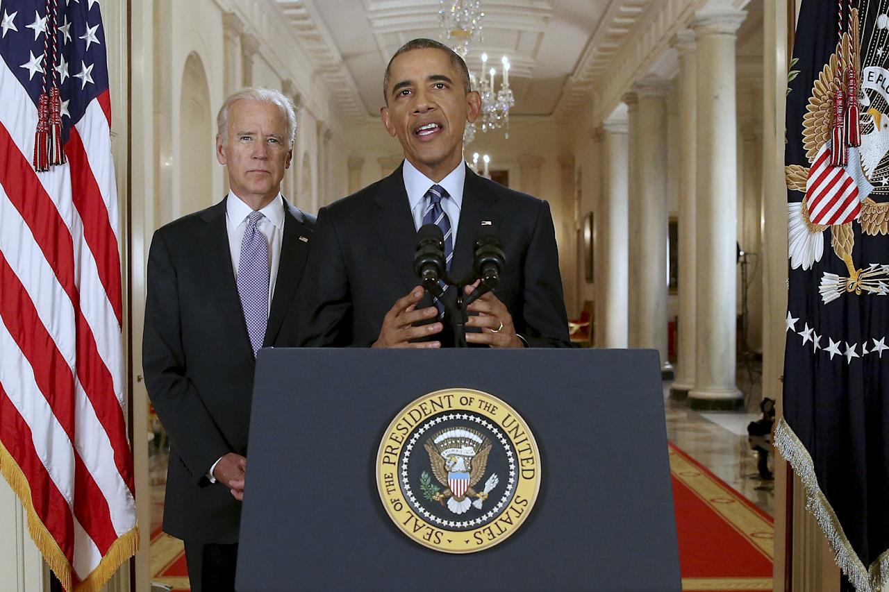 U.S. President Barack Obama delivers a statement after a  nuclear deal was reached between Iran and six major world powers, beside Vice President Joe Biden, in the East Room of the White House in Washington, July 14, 2015. The nuclear deal between world powers and Iran starts a new phase of intense negotiation - this time between the Obama administration and the U.S. Congress, where some Republicans have long been working to sink an agreement.  REUTERS/Andrew Harnik/Pool