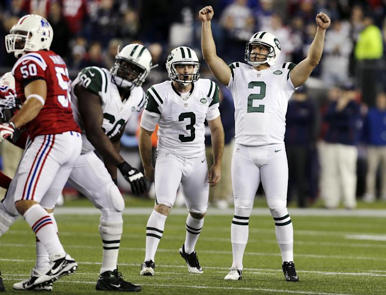 New York Jets kicker Nick Folk (2) celebrates his second field goal of the fourth quarter with holder Robert Malone (3) during an NFL football game against the New England Patriots in Foxborough, Mass., Sunday, Oct. 21, 2012. (AP Photo/Charles Krupa)