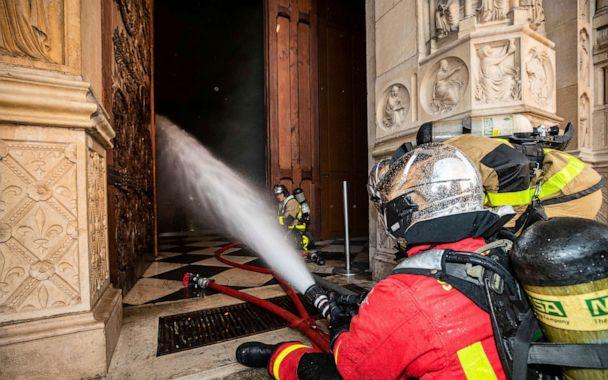 PHOTO: Fire fighters spray water inside Notre Dame cathedral, April 15, 2019. (Benoit Moser, BSPP via AP)