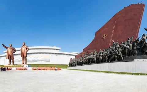 <span>Statues of Kim Il-Sung and Kim Jong-il</span> <span>Credit: GETTY </span>