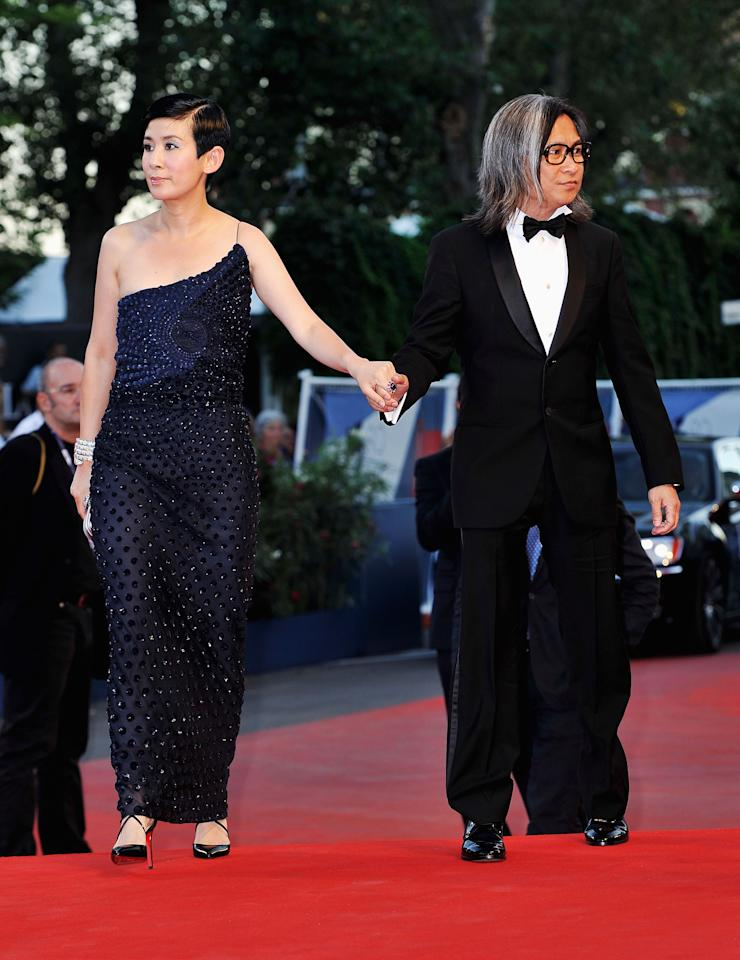 "VENICE, ITALY - SEPTEMBER 08:  Jury member Peter Ho-Sun Chan (R) and his partner Sandra Ng attend Award Ceremony And ""L'Homme Qui Rit"" Premiere during The 69th Venice Film Festival at the Palazzo del Cinema on September 8, 2012 in Venice, Italy.  (Photo by Gareth Cattermole/Getty Images)"