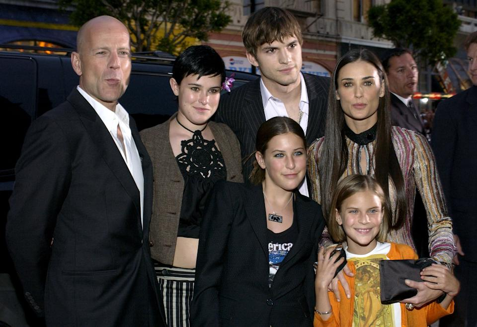 Bruce Willis, Ashton Kutcher and Demi Moore with daughters (Photo by L. Cohen/WireImage)