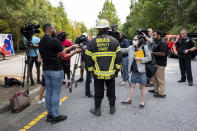 DeKalb County Fire Rescue Deputy Chief Melvin Carter briefs journalists as emergency workers respond following an apartment explosion, Sunday, Sept. 12, 2021, in Dunwoody, Ga., just outside of Atlanta. (AP Photo/Ben Gray)