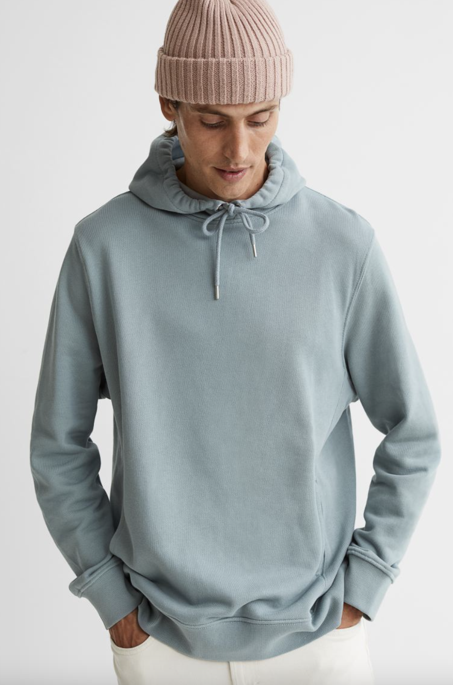 male model wearing light pink hat and Regular Fit Hoodie in Turquoise