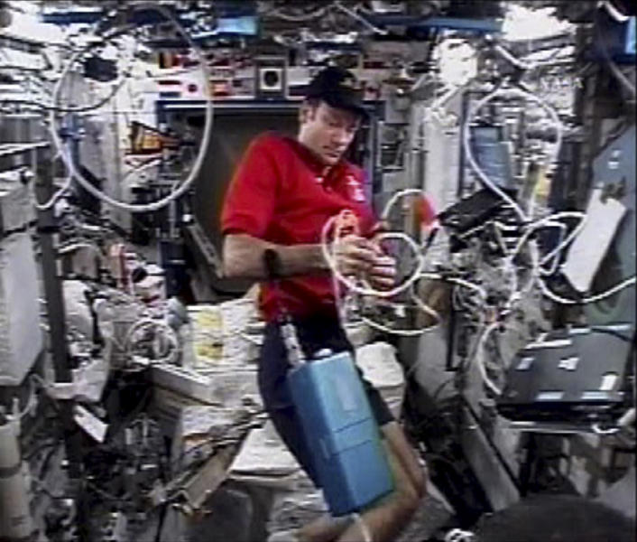 FILE - This Dec. 19, 2006 video file image provided by NASA TV shows Commander Michael Lopez-Alegria working aboard the International Space Station. Astronauts have a down-to-Earth problem that could be even worse on a long trip to Mars: They can't get enough sleep. And over time, the lack of slumber can turn intrepid space travelers into drowsy couch potatoes, a new study shows. Lopez-Alegria, who holds the American record for longest space mission, said he could relate to the study findings. (AP Photo/NASA TV, File)